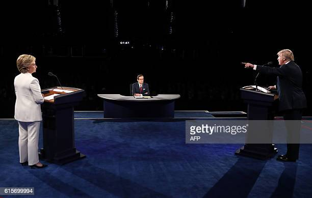 TOPSHOT Democratic nominee Hillary Clinton and Republican nominee Donald Trump take part in the final presidential debate at the Thomas Mack Center...