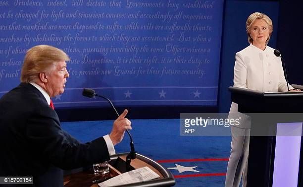 TOPSHOT Democratic nominee Hillary Clinton looks on as Republican nominee Donald Trump speaks during the final presidential debate at the Thomas Mack...