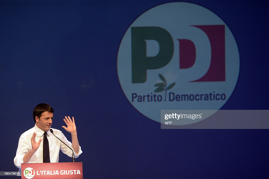 Democratic Party (PD) and Florence's mayor Matteo Renzi addresses the audience on stage during an electoral rally with secretary general Pierluigi Bersani on February 1, 2013 in Florence. Italians take to the polls on February 24-25.