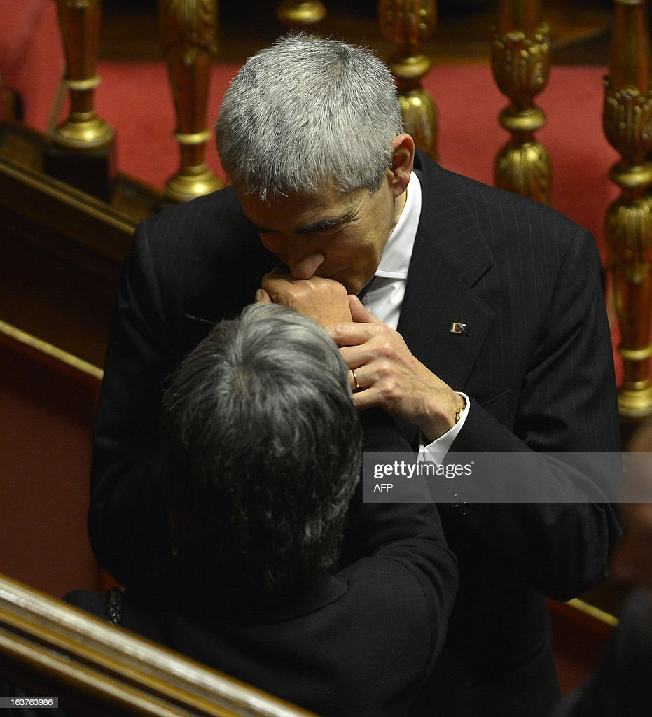Democratic Party Anna Finocchiaro (L) is greeted by centrist Pier Ferdinando Casini during the first session of the senate on March 15, 2013 in Rome. General election in Italy took place on February 26 but as a majority in both chambers of parliament is required to form a government, Italy is left in a state of limbo with a hung parliament that is unprecedented in its post-war history. AFP PHOTO / ALBERTO LINGRIA