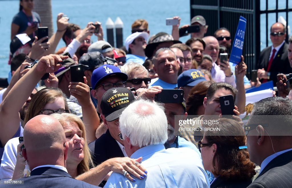 Democratic Party candidate Bernie Sanders greets his supporters following a speech on May 27, 2016 in the San Pedro port district of Los Angeles, California, ahead of the June 7 California vote. / AFP / FREDERIC