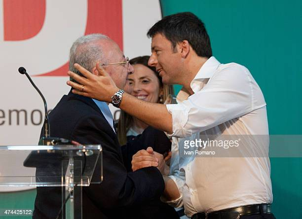 Democratic Party candidate Vincenzo De Luca shakes hands with Italian Prime Minister Matteo Renzi during a party conference at the hotel...