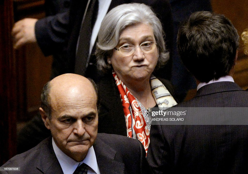 Democratic Party (PD) general secretary Pier Luigi Bersani (L) and PD president Rosy Bindi (C) arrive to vote for the election of Italy's President on April 20, 2013 at the Italian parliament in Rome. Italy's 87-year-old President Giorgio Napolitano said today he would run for a second term despite earlier ruling out the prospect, following an appeal from the main parties to help defuse an increasingly tense political crisis.'I consider it necessary to offer my availability,' Napolitano said in a statement, as bickering lawmakers prepared for a sixth round of voting in parliament that he is now expected to win by a large margin.