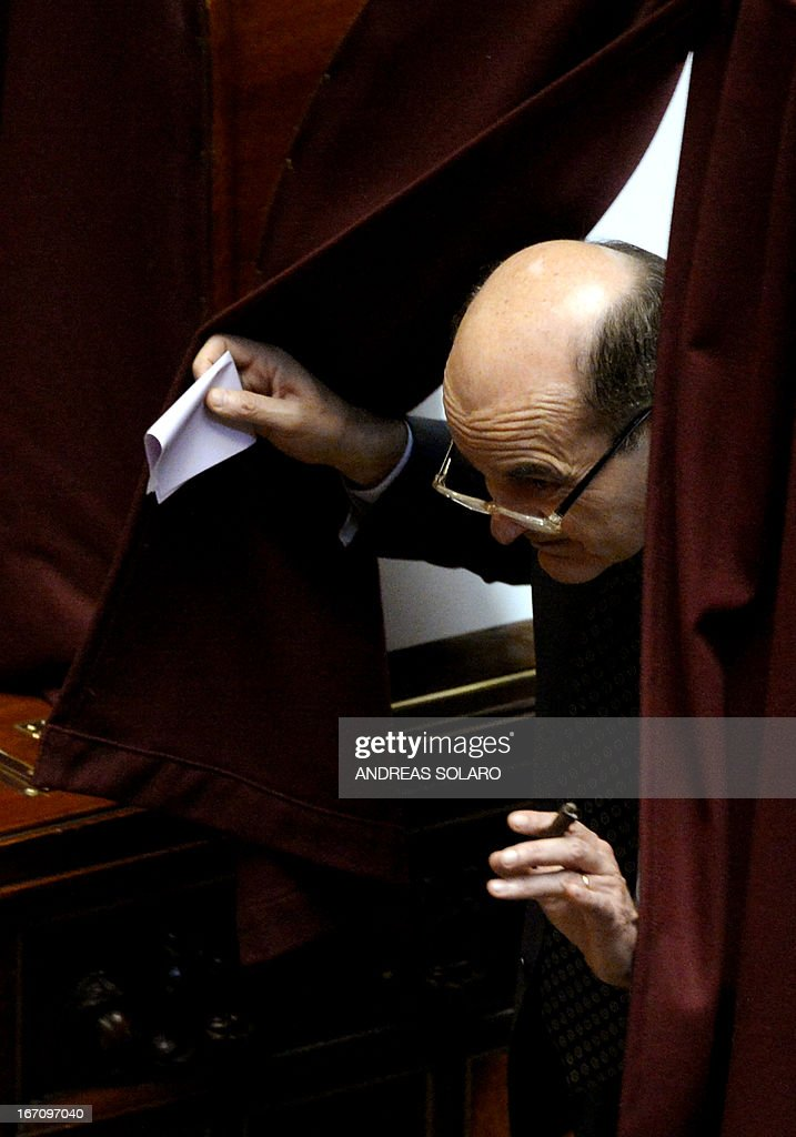 Democratic Party (PD) general secretary Pier Luigi Bersani leaves the voting booth to vote for the election of Italy's President on April 20, 2013 at the Italian parliament in Rome. Italy's 87-year-old President Giorgio Napolitano said today he would run for a second term despite earlier ruling out the prospect, following an appeal from the main parties to help defuse an increasingly tense political crisis.'I consider it necessary to offer my availability,' Napolitano said in a statement, as bickering lawmakers prepared for a sixth round of voting in parliament that he is now expected to win by a large margin.