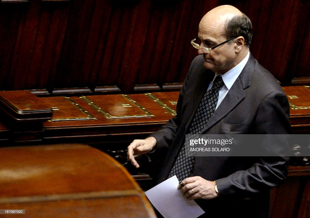 Democratic Party (PD) general secretary Pier Luigi Bersani prepares to vote for the election of Italy's President on April 20, 2013 at the Italian parliament in Rome. Italy's 87-year-old President Giorgio Napolitano said today he would run for a second term despite earlier ruling out the prospect, following an appeal from the main parties to help defuse an increasingly tense political crisis.'I consider it necessary to offer my availability,' Napolitano said in a statement, as bickering lawmakers prepared for a sixth round of voting in parliament that he is now expected to win by a large margin. AFP PHOTO / ANDREAS SOLARO