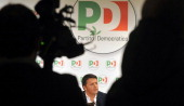 Democratic Party leader Matteo Renzi gives a press conference after a meeting with Italy's former Prime minister Silvio Berlusconi in Rome on January...