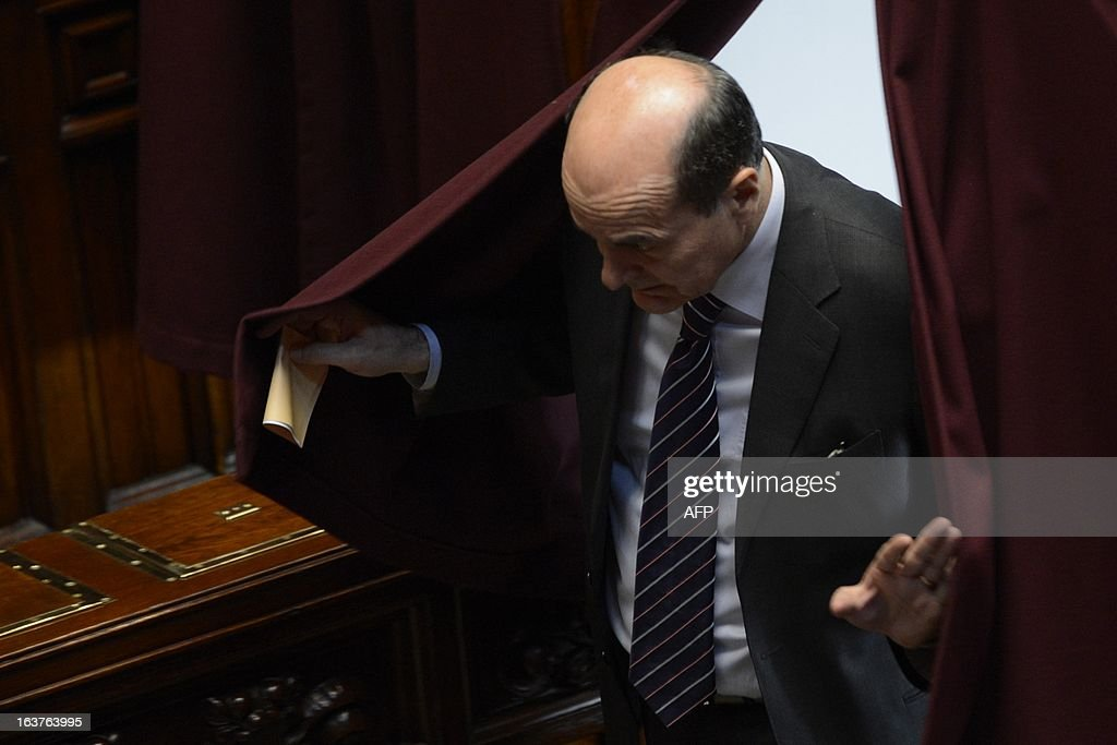 Democratic Party (PD) leader Pier Luigi Bersani arrives to cast his ballot during the first session of Italian lower-house on March 15, 2013 in Rome. General election in Italy took place on February 26 but as a majority in both chambers of parliament is required to form a government, Italy is left in a state of limbo with a hung parliament that is unprecedented in its post-war history.