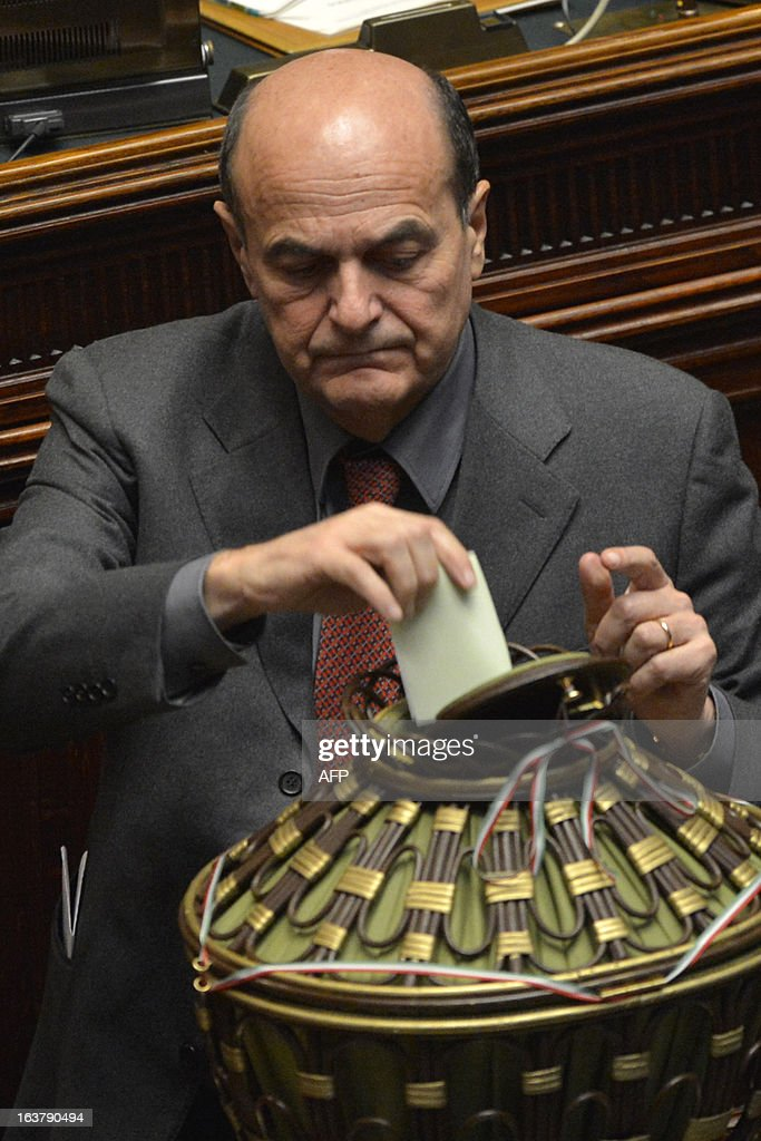 Democratic party leader Pier Luigi Bersani casts his ballot on the second session of Italian lower-house on March 16, 2013 in Rome.Italy's new parliament met the day before for the first time since a deadlocked election that left no clear winner and saw the astonishing rise of a protest party that wants a referendum on the euro.