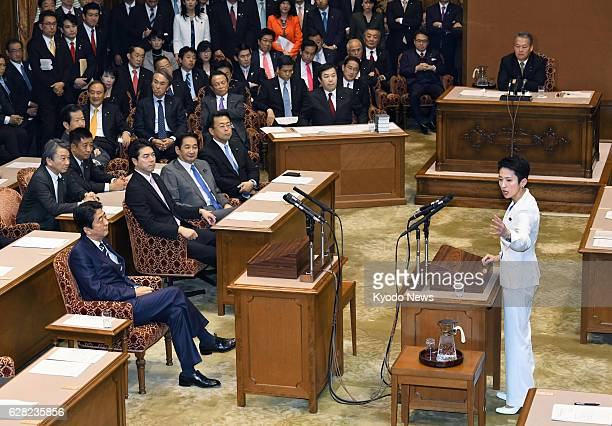 Democratic Party leader Renho speaks to Prime Minister and Liberal Democratic Party chief Shinzo Abe in Tokyo on Dec 7 in their first leaders' debate...