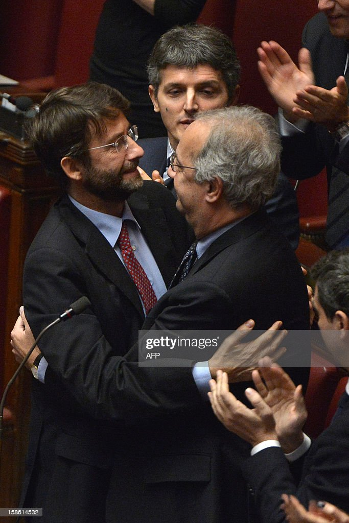 Democratic Party (PD) member of parliament Walter Veltroni (R) is greeted by colleague Dario Franceschini for his last appearance at the lower-house during a session on a key budget vote on December 21, 2012 in Rome. The Italian parliament prepared Friday for a key budget vote which will trigger the resignation of Prime Minister Mario Monti, who is expected to reveal this weekend whether he will run in the upcoming election. AFP PHOTO / ALBERTO PIZZOLI