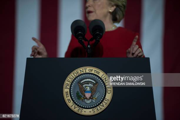 Democratic party nominee Hillary Clinton gives a speach from the US PResident stand during a rally for Democratic presidential nominee Hillary...