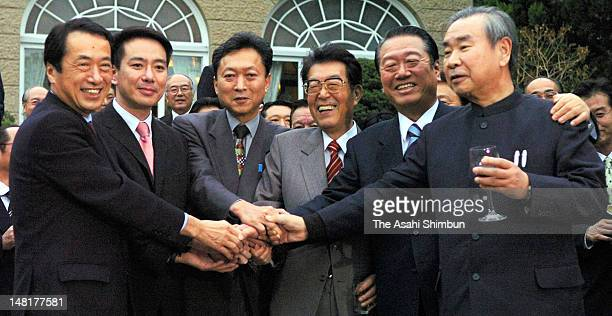 Democratic Party of Japan lawmakers Naoto Kan Seiji Maehara YUkio Hatoyama Kozo Watanabe Ichiro Ozawa and Tsutomu Hata shake hands during the cherry...