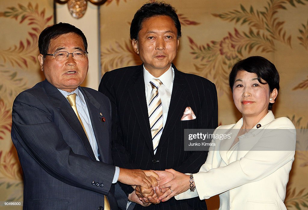 Democratic Party of Japan (DPJ) president and incoming Prime Minister Yukio Hatoyama (C), Social Democratic Party leader Mizuho Fukushima (R) and The People's New Party Shizuka Kamei (L) attend the leaders meeting at the Diet building on September 9, 2009 in Tokyo, Japan. DPJ secured 308 seats out of 480 in the lower house election but still need the coalition with these two parties to keep control in the upper house.