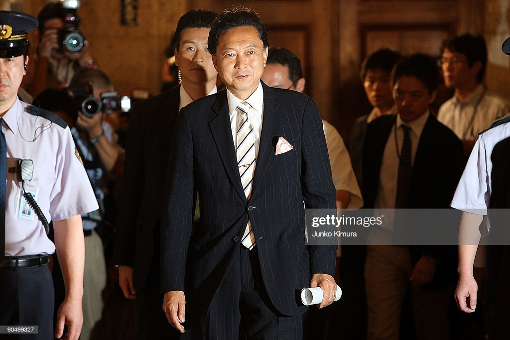 Democratic Party of Japan (DPJ) president and incoming Prime Minister Yukio Hatoyama (C) arrives at a meeting with Social Democratic Party leader Mizuho Fukushima and The People's New Party Shizuka Kamei at the Diet building on September 9, 2009 in Tokyo, Japan. DPJ secured 308 seats out of 480 in the lower house election but still need the coalition with these two parties to keep control in the upper house.