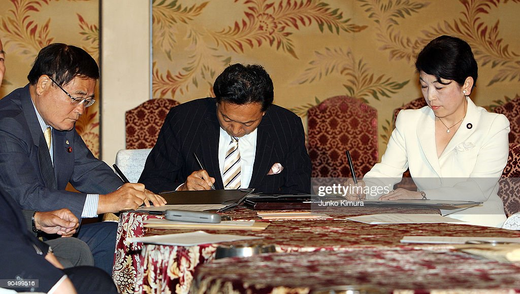 Democratic Party of Japan (DPJ) president and incoming Prime Minister Yukio Hatoyama (C), Social Democratic Party leader Mizuho Fukushima (R) and The People's New Party Shizuka Kamei (L) sign documents to exchange during the leaders meeting at the Diet building on September 9, 2009 in Tokyo, Japan. DPJ secured 308 seats out of 480 in the lower house election but still need the coalition with these two parties to keep control in the upper house.