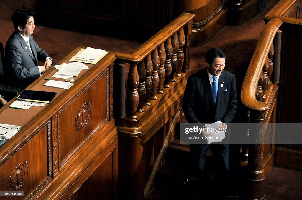 Democratic Party of Japan president Banri Kaieda smiles on the way back to his seat after the party representatives' questioning at the lower house on January 30, 2013 in Tokyo, Japan.