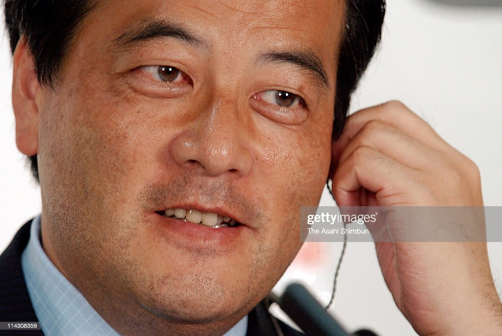 Democratic Party of Japan (DPJ) President <a gi-track='captionPersonalityLinkClicked' href=/galleries/search?phrase=Katsuya+Okada&family=editorial&specificpeople=226520 ng-click='$event.stopPropagation()'>Katsuya Okada</a> smiles during the press conference at DPJ headquarters on July 12, 2004 in Tokyo, Japan.