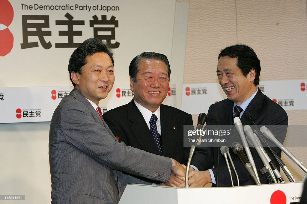Democratic Party of Japan (DPJ) Secretary General <a gi-track='captionPersonalityLinkClicked' href=/galleries/search?phrase=Yukio+Hatoyama&family=editorial&specificpeople=705513 ng-click='$event.stopPropagation()'>Yukio Hatoyama</a>, President <a gi-track='captionPersonalityLinkClicked' href=/galleries/search?phrase=Ichiro+Ozawa&family=editorial&specificpeople=680192 ng-click='$event.stopPropagation()'>Ichiro Ozawa</a> and Acting President <a gi-track='captionPersonalityLinkClicked' href=/galleries/search?phrase=Naoto+Kan&family=editorial&specificpeople=697761 ng-click='$event.stopPropagation()'>Naoto Kan</a> shake hands after their candidate Kazumi Ota (not pictured) winning in the by-election of the lower house Chiba 7th Constituency at the DPJ headquaters on April 23, 2006 in Tokyo, Japan.
