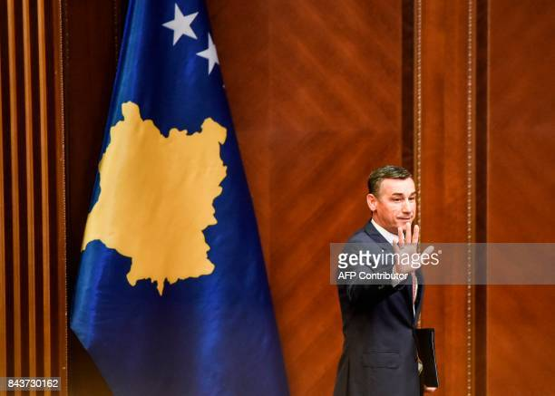 Democratic Party of Kosovo leader Kadri Veseli waves during a session of Kosovo's parliament on September 7 2017 in Pristina Democratic Party of...
