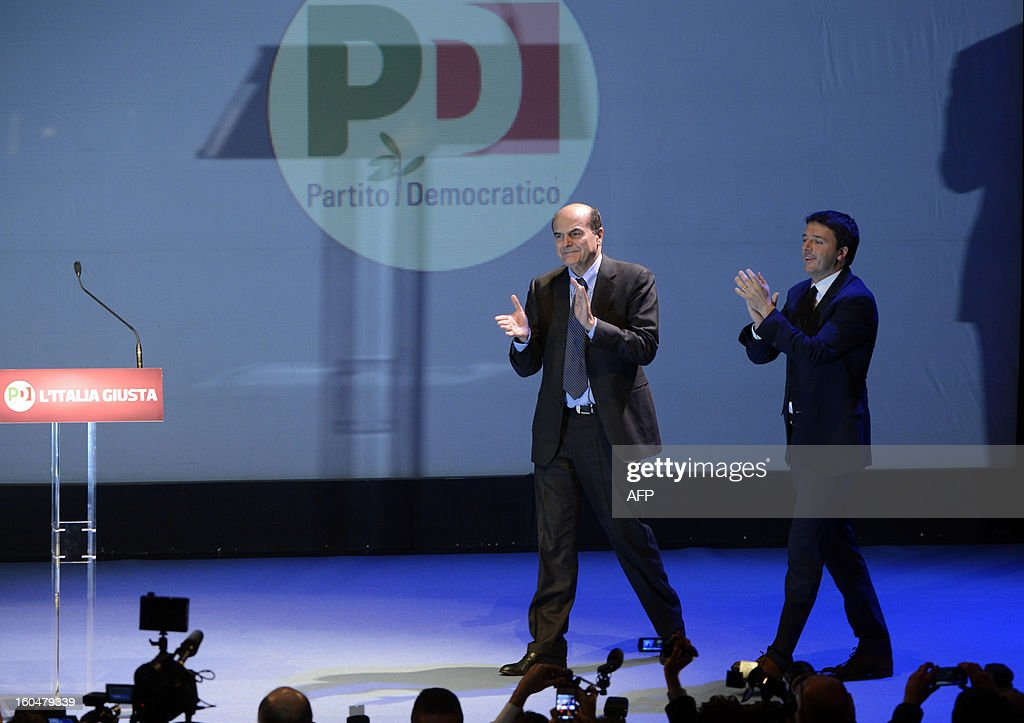 Democratic Party (PD) secretary general Pierluigi Bersani (L) and Florence's mayor Matteo Renzi arrive on stage during an electoral rally on February 1, 2013 in Florence. Italians take to the polls on February 24-25.