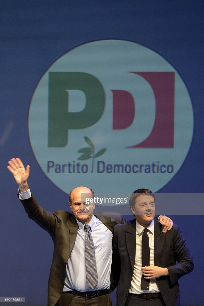Democratic Party (PD) secretary general Pierluigi Bersani (L) and Florence's mayor Matteo Renzi walk on stage during an electoral rally on February 1, 2013 in Florence. Italians take to the polls on February 24-25.