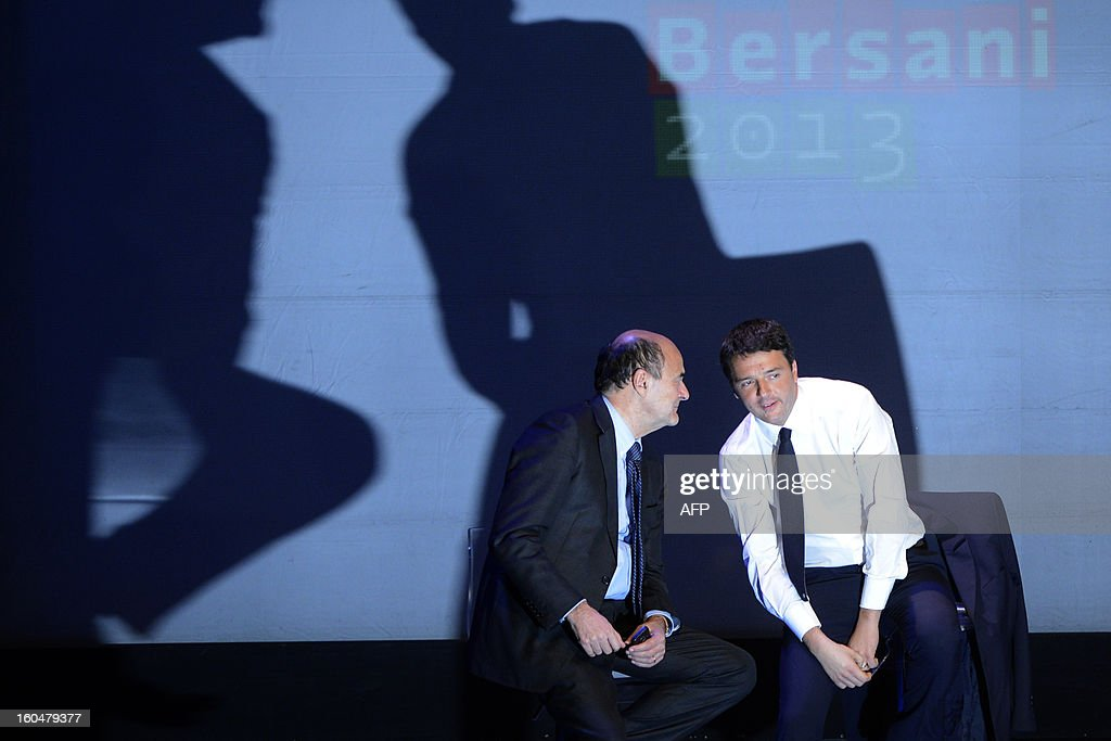 Democratic Party (PD) secretary general Pierluigi Bersani (L) and Florence's mayor Matteo Renzi chat on stage during an electoral rally on February 1, 2013 in Florence. Italians take to the polls on February 24-25.