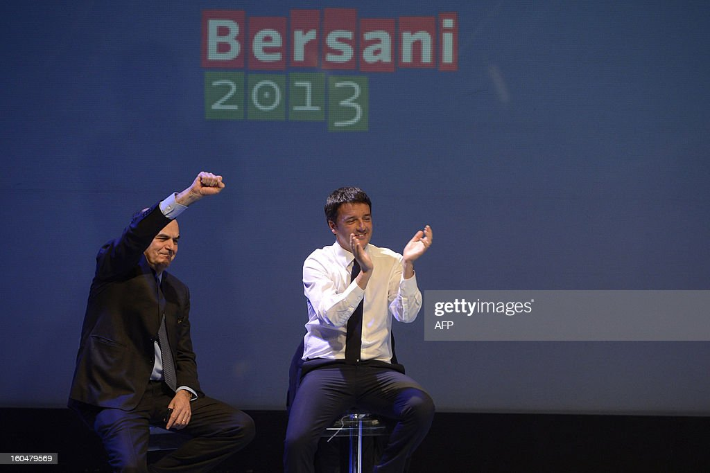 Democratic Party (PD) secretary general Pierluigi Bersani (L) and Florence's mayor Matteo Renzi wave on stage during an electoral rally on February 1, 2013 in Florence. Italians take to the polls on February 24-25.