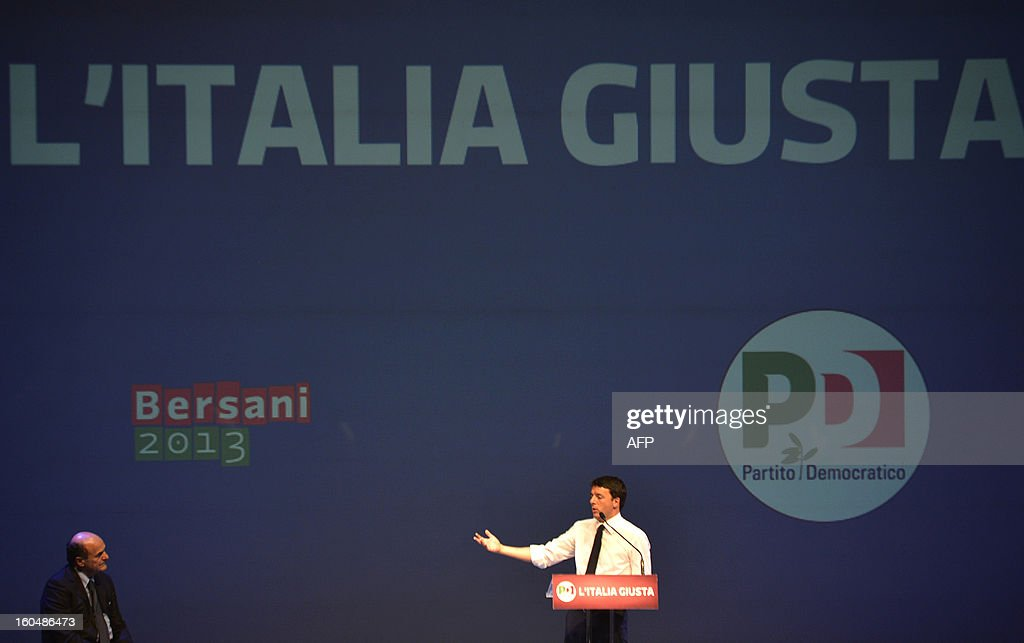 Democratic Party (PD) secretary general Pierluigi Bersani (L) and Florence's mayor Matteo Renzi stand on stage during an electoral rally on February 1, 2013 in Florence. Italians take to the polls on February 24-25. AFP PHOTO / ANDREAS SOLARO