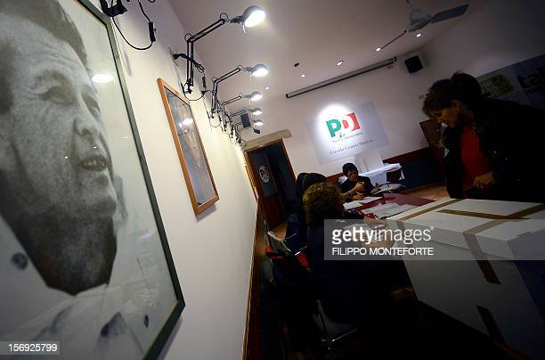 A Democratic Party supporter casts her ballot at a party polling station during the PD primary election on November 25 2012 in Rome Centreleft voters...