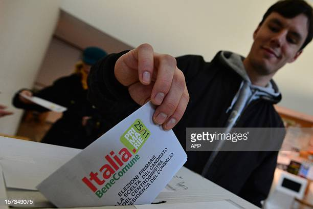 A Democratic Party supporter casts his ballot at a party polling station during the PD primary election on December 2 2012 in Milan Centreleft voters...