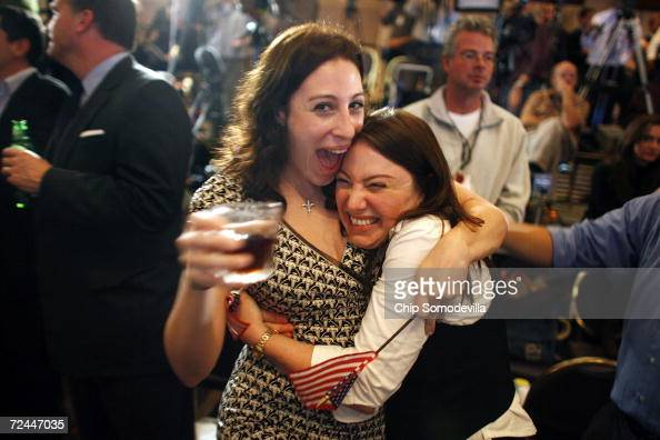 Democratic Party supporters cheer at the news that the party has won the 15 necessary seats to take over the House of Representatives at the Hyatt...