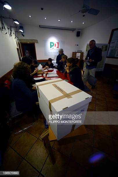 Democratic Party supporters queue at a party polling station to choose between five candidates in the primary election on November 25 2012 in Rome...