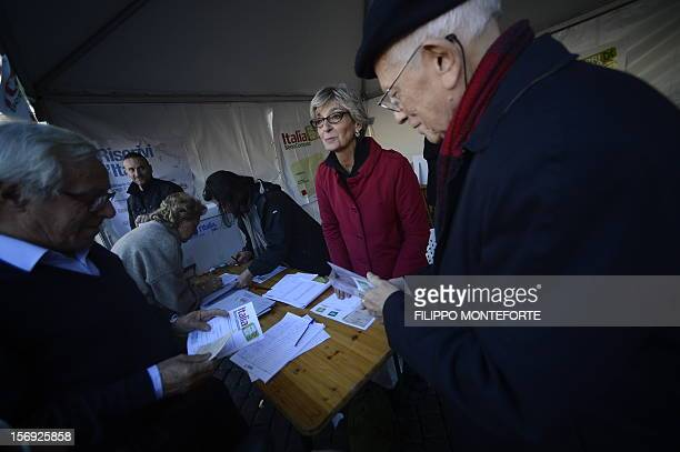Democratic Party supporters queue in front of a party polling station to choose between five candidates in the primary election on November 25 2012...