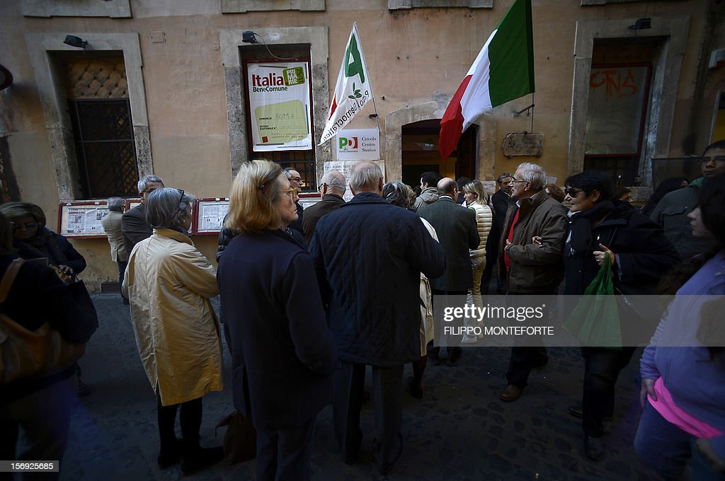 Democratic Party (PD) supporters wait in front of a party polling station to choose between five candidates in the primary election on November 25, 2012 in Rome. Centre-left voters in recession-hit Italy went to the polls on Sunday to choose the Democratic Party candidate who will run for prime minister in an election early next year that it is widely expected to win.