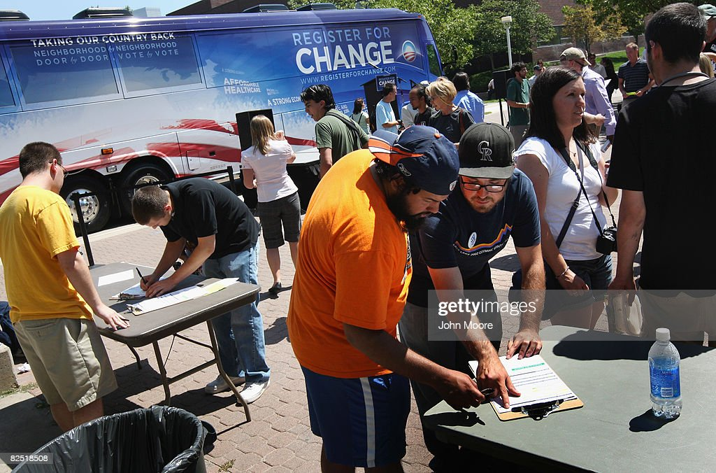 A Democratic party volunteer (L), answers questions during a voter registration drive August 22, 2008 in Denver, Colorado. Dean kicked off a series of political events surrounding the Democratic National Convention, which starts in Denver on Monday. Convention delegates from around the country are set to nominate Barack Obama as their Presidential candidate next Thursday.