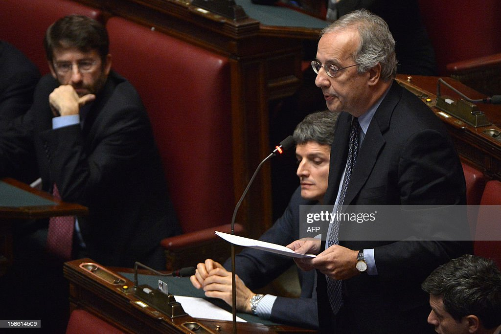 Democratic Party (PD) Walter Veltroni reacts during a session on a key budget vote on December 21, 2012 in Rome. The Italian parliament prepared Friday for a key budget vote which will trigger the resignation of Prime Minister Mario Monti, who is expected to reveal this weekend whether he will run in the upcoming election.