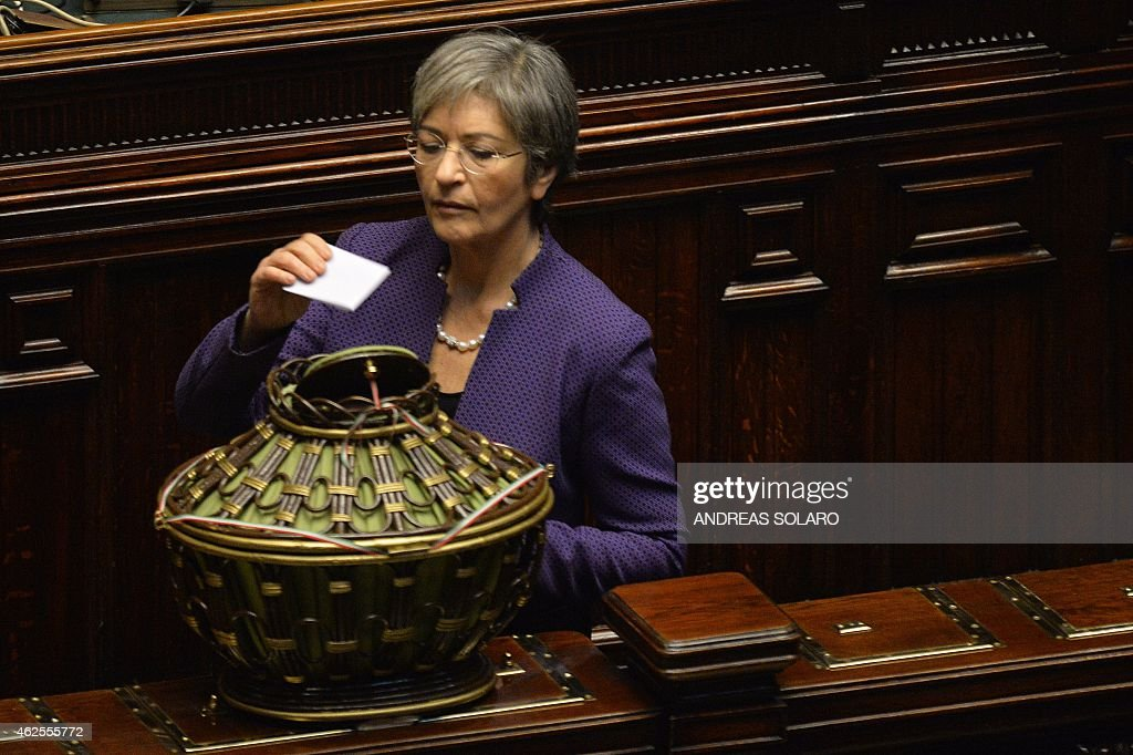 Democratic Party's leader at the Italian Senate, <a gi-track='captionPersonalityLinkClicked' href=/galleries/search?phrase=Anna+Finocchiaro&family=editorial&specificpeople=4172756 ng-click='$event.stopPropagation()'>Anna Finocchiaro</a>, casts her ballot on January 31, 2015 at the Italian Parliament in Rome during the fourth round of vote for the election of a new President, after Giorgio Napolitano resigned on January 14. Italian Prime Minister Matteo Renzi backed a little-known Constitutional Court judge, whose brother was slain by the mafia, to be Italy's next president. White-haired Sicilian Sergio Mattarella, 73, will be supported by Renzi's ruling Democratic Party in a multi-round election to produce a successor to the recently retired Giorgio Napolitano on January 31, the premier said ahead of an inconclusive first vote. AFP PHOTO / ANDREAS SOLARO