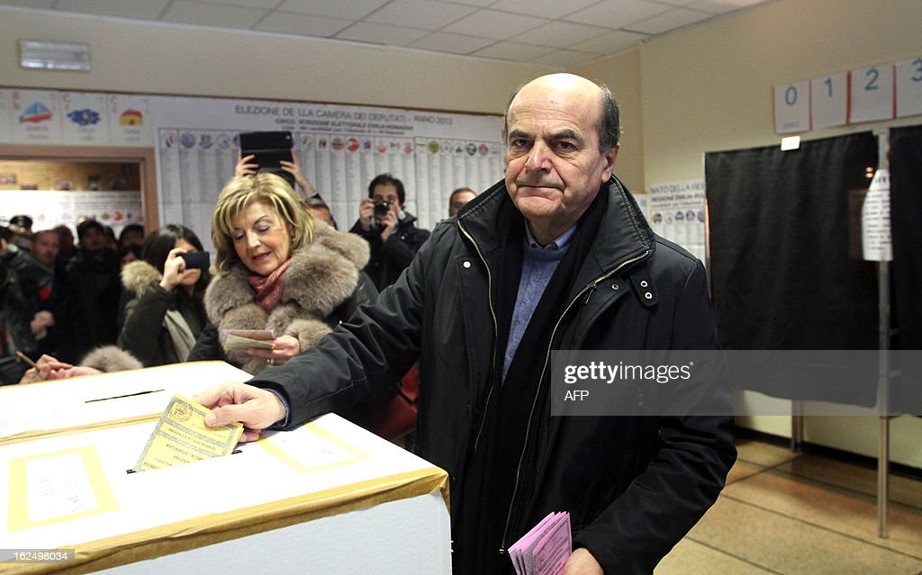 Democratic Party's Pier Luigi Bersani, the favourite to become Italy's prime minister after the general election, casts his ballot in a polling station on February 24, 2013 in Piacenza. Italians fed up with austerity went to the polls on Sunday in elections where the centre-left is the favourite, as Europe held its breath for signs of fresh instability in the eurozone's third economy. AFP PHOTO / ALBERTO LINGRIA
