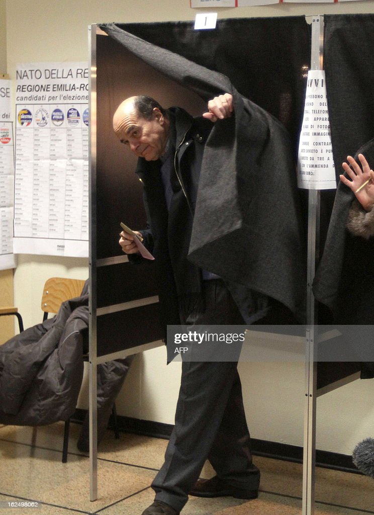 Democratic Party's Pier Luigi Bersani, the favourite to become Italy's prime minister after the general election, leaves the voting booth to cast his ballot in a polling station on February 24, 2013 in Piacenza. Italians fed up with austerity went to the polls on Sunday in elections where the centre-left is the favourite, as Europe held its breath for signs of fresh instability in the eurozone's third economy. AFP PHOTO / ALBERTO LINGRIA