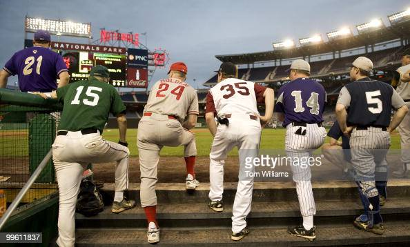 Democratic players watch the 48th Annual Roll Call Congressional Baseball Game held at Nationals Stadium June 17 2009