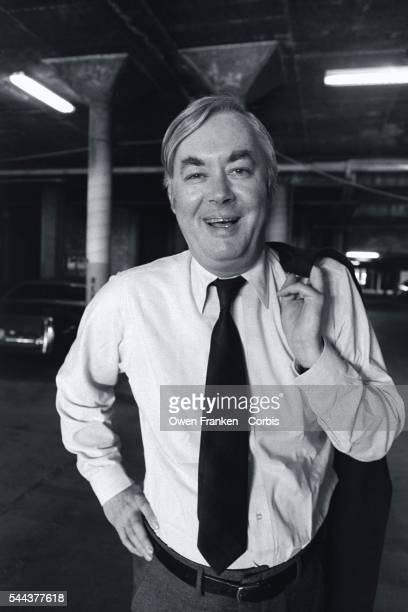 Democratic politician Daniel Patrick Moynihan carries his jacket over his shoulder