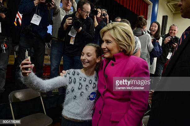 Democratic president candidate Hillary Clinton takes pictures with people following a town hall event at Woodbury School December 8 2015 in Salem New...