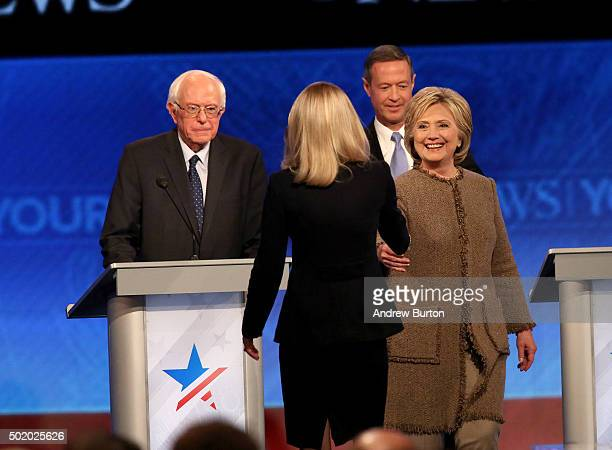 Democratic president candidates Bernie Sanders Hillary Clinton and Martin O'Malley greet the moderator following the debate at Saint Anselm College...
