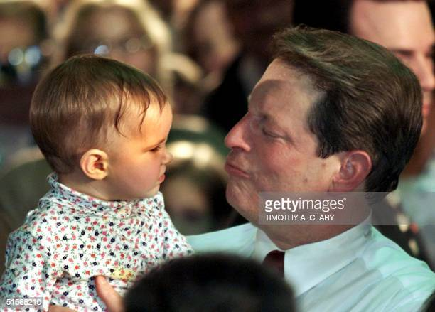 Democratic presidental candidate Al Gore holds a baby as he works the crowd at a rally at a United Auto Workers' Hall during a campaign stop in Flint...