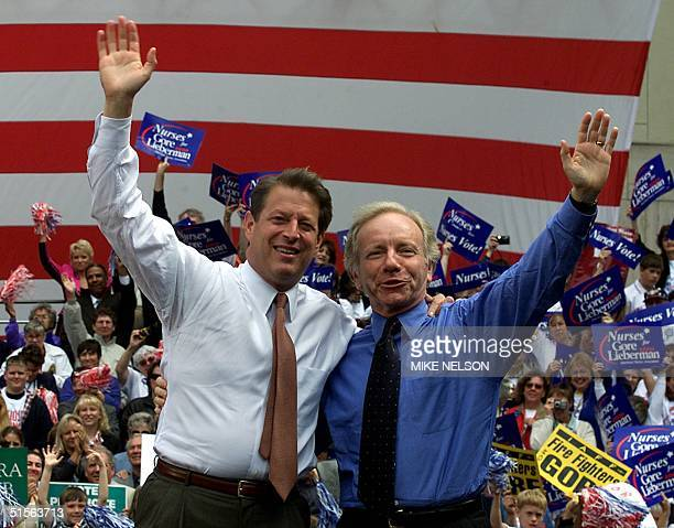 Democratic presidential candidate Al Gore and his running mate Joe Lieberman wave following a campaign speech in downtown Seattle about improving...