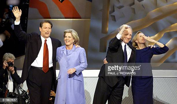 Democratic presidential candidate Al Gore and his wife Tipper are joined on stage by vice presidential candidate Joseph Lieberman pumping his fist as...