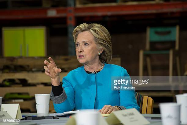 Democratic presidential candidate and former Secretary of State and senator Hillary Rodham Clinton speaking at a round table discussion with...