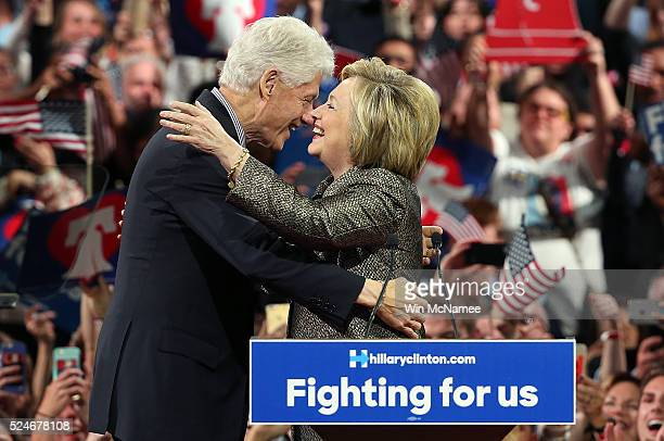 Democratic presidential candidate and former US Secretary of State Hillary Clinton embraces her husband former President Bill Clinton at a primary...