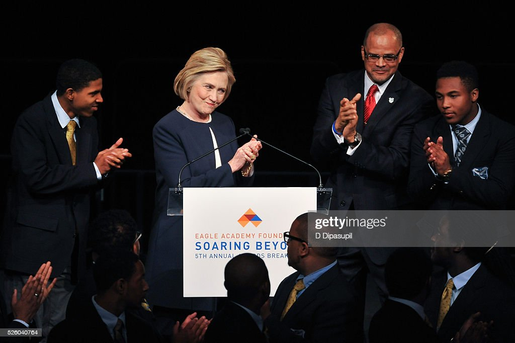 Democratic presidential candidate and former U.S. Secretary of State <a gi-track='captionPersonalityLinkClicked' href=/galleries/search?phrase=Hillary+Clinton&family=editorial&specificpeople=76480 ng-click='$event.stopPropagation()'>Hillary Clinton</a> (2nd L) and Eagle Academy Foundation president and CEO David C. Banks (2nd R) attend the 2016 Eagle Academy Foundation Fundraising Breakfast at Gotham Hall on April 29, 2016 in New York City.
