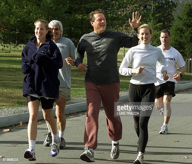 Democratic presidential candidate and US Vice President Al Gore jogs with his family including his daughters Kristin Karenna Gore Schiff and his...
